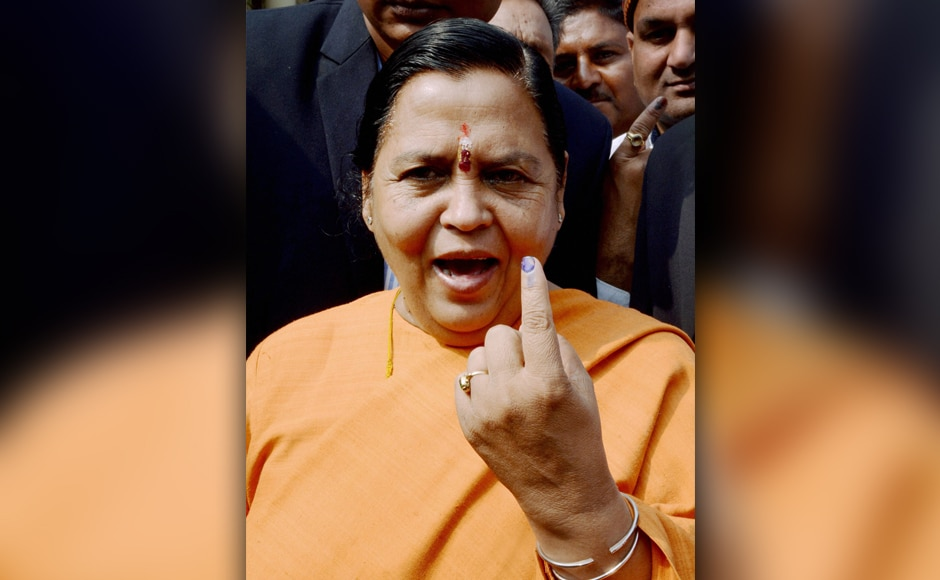 Union Water Resources Minister Uma Bharti shows her inked finger after casting her vote in the third phase of the Uttar Pradesh Assembly elections in Lucknow on Sunday. PTI