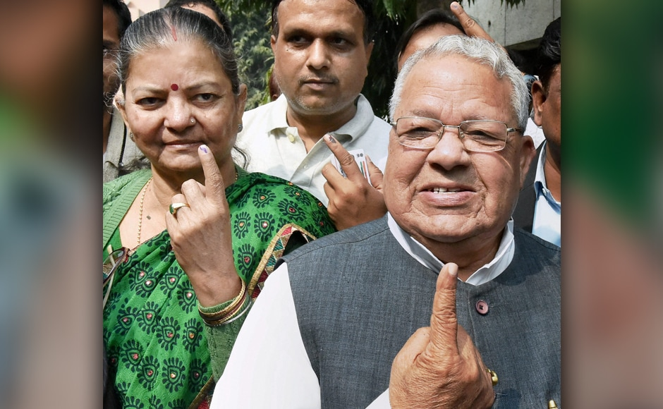 Kalraj Mishra, Union Minister for Micro, Small and Medium Enterprises (MSME), with his wife, after casting their votes in Lucknow on Sunday. PTI