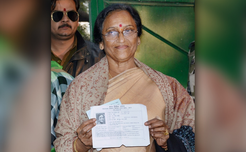 BJP candidate Rita Bahuguna Joshi shows her inked finger after casting her vote in the third phase of the Uttar Pradesh Assembly elections in Lucknow on Sunday. PTI