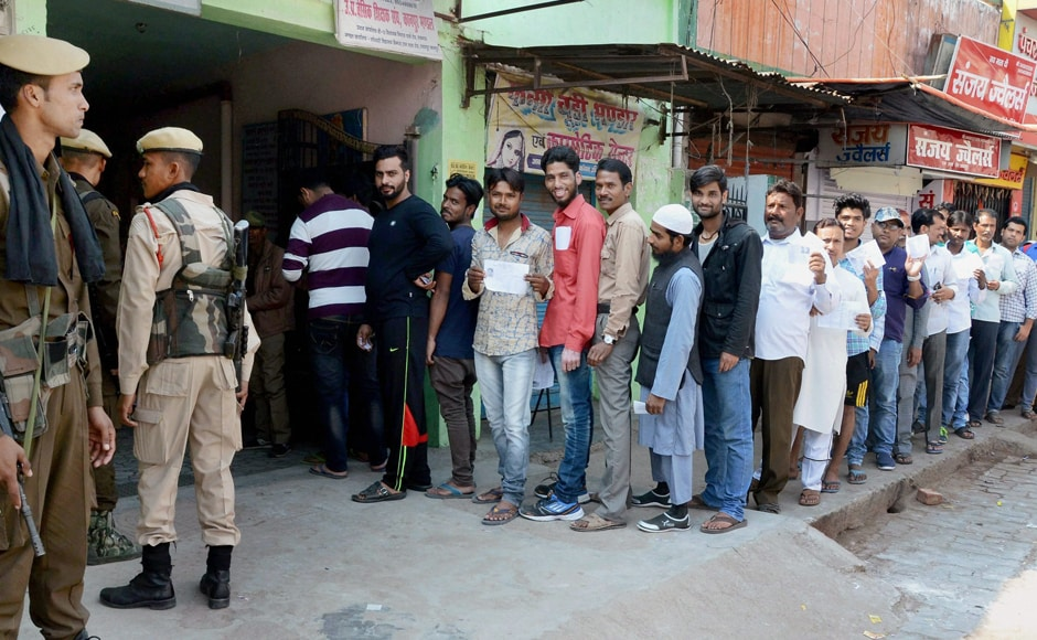 Voters queue up to cast their votes in Kanpur on Sunday. Over 61.16 percent of the state's electorate exercised their franchise to decide the fate of 826 candidates across the state's69 Assembly constituencieson Sunday. PTI