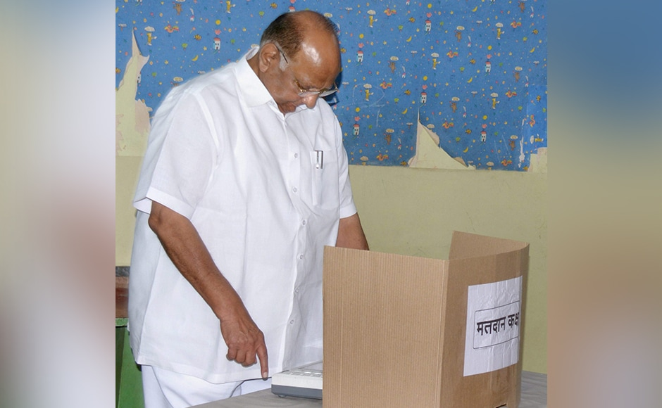 NCP Chief Sharad Pawar casting his vote for the Mumbai Corporation Election near Mahalakshmi Temple in South Mumbai on Tuesday. PTI