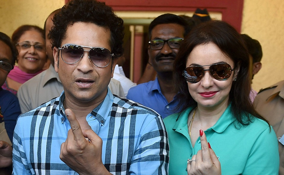 Cricket legend Sachin Tendulkar along with wife Anjali Tendulkar display the indelible ink mark on their fingers after casting the vote for the municipal corporation election in Mumbai on Tuesday. PTI