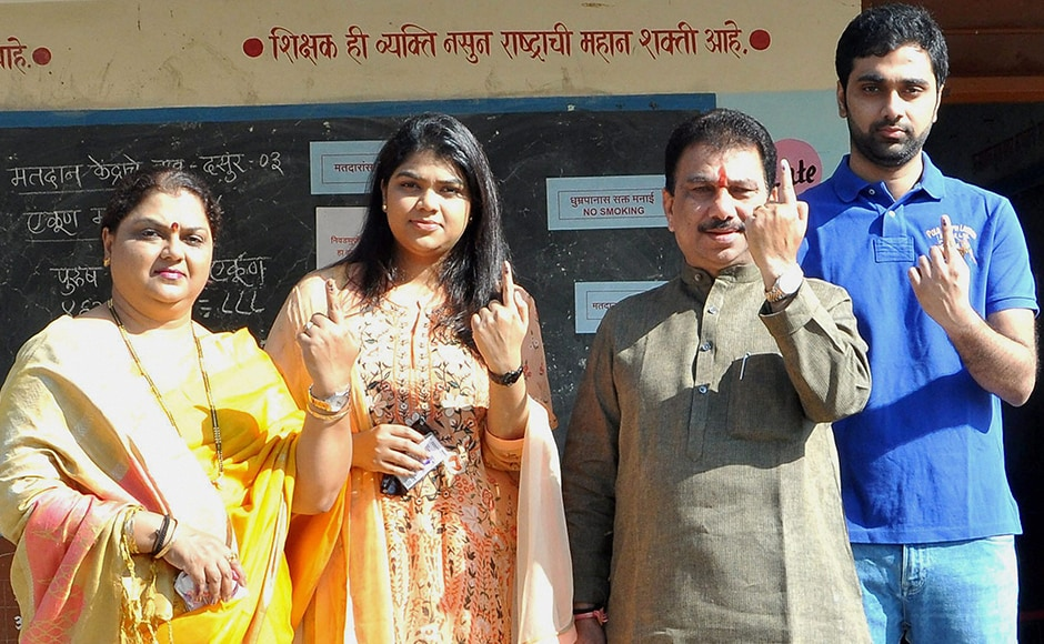 NCP MLA Hanumant Dolas with his family members display the indelible ink mark after casting vote for the municipal corporation election at Dasur village in Solapur, Maharashtra on Tuesday. PTI