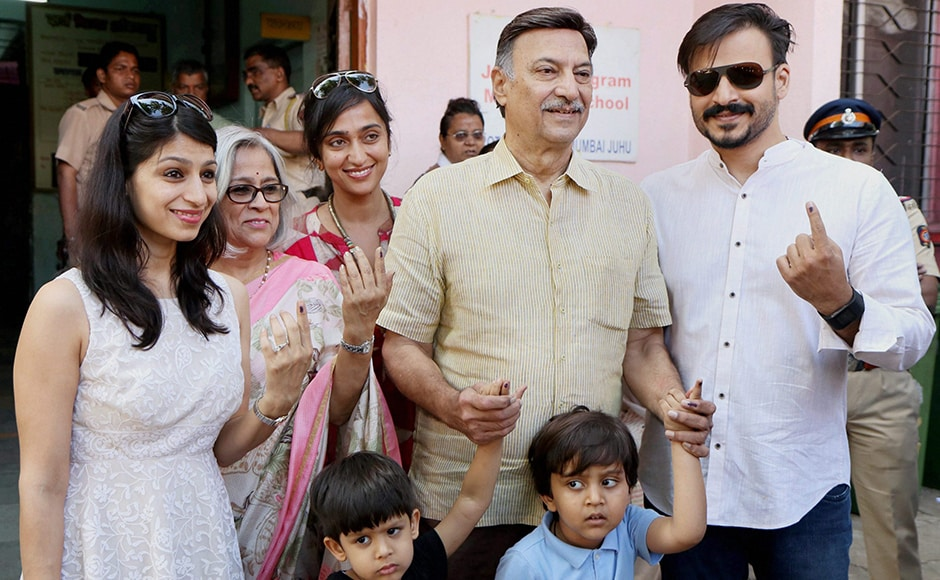 Bollywood actor Vivek Oberoi, along with his father Suresh Oberoi, mother, sister, wife and sons after casting their votes at Juhu in Mumbai on Tuesday. PTI