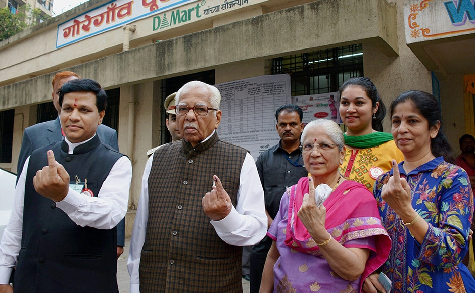 UP Governor Ram Naik (R) and his wife Kunda show marked fingers after casting votes for Mumbai Corporation Election at Goregaon in north Mumbai on Tuesday. PTI