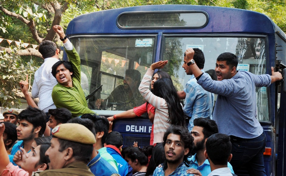 Students were protesting over Umar Khalid's invite to a seminar at Ramjas College while police personnels tried to rein them in at Delhi University on Wednesday. PTI