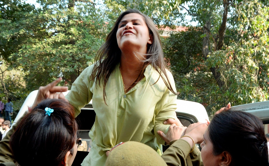 Police detain one of the ABVP students after their clash with All India Students Association (AISA) members at Delhi University's north campus Wednesday. PTI