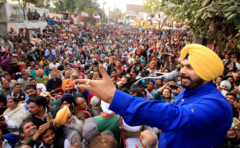 Congress leader Navjot Singh Sidhu addressing an elections rally in support of party candidate Manpreet Singh Badal in Bathinda. Sidhu was a BJP star campaigner in previous elections and also a Rajya Sabha MP. He later quit BJP, apparently miffed as he was denied a ticket from his traditional Amritsar seat in the elections. After many flip flops, he finally settled for the BJP's arch rival.