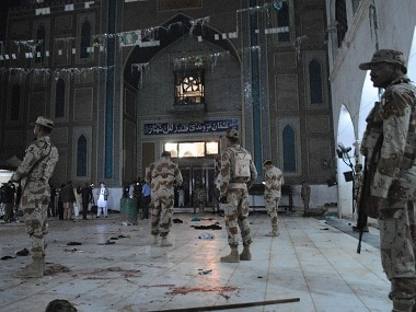 Pakistani para-military soldiers stand alert after a deadly suicide attack at the shrine of famous Sufi Lal Shahbaz Qalandar in Sehwan, Pakistan, Thursday, Feb. 16, 2017. An Islamic State suicide bomber targeted worshippers at a shrine in southern Pakistan on Thursday. AP