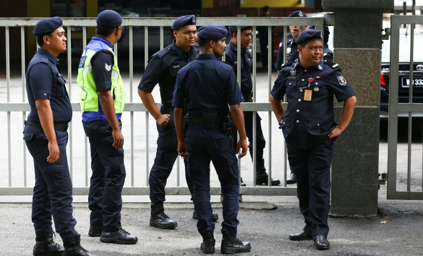 Malaysian police officers in front of the morgue at Kuala Lumpur General Hospital where Kim Jong Nam's body is held for autopsy. Reuters