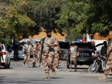 Paramilitary soldiers gather outside the Afghan consulate. Reuters