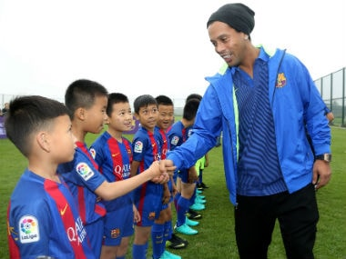 Ronaldinho met with kids at the launch. AFP