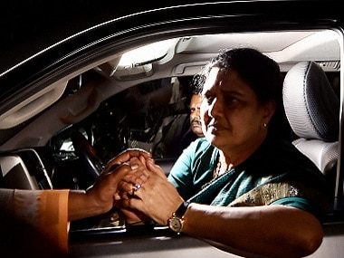 VK Sasikala is consoled by a lady on her way from to Poes Garden. PTI