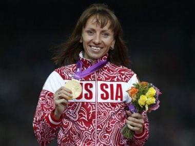 File photo of Russia's Mariya Savinova holding her gold medal for women's 800m at the London Olympics. Reuters