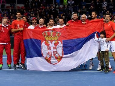 Serbia's tennis team celebrate their victory over Russia during the first round Davis Cup World Group tie. AFP