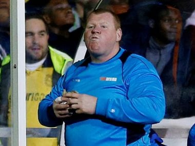 Sutton United's substitute Wayne Shaw eats a pie during the FA Cup match. Reuters