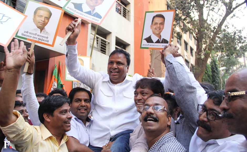 BJP party leader Aashish Shelar enjoys with other party workers on Friday. Sachin Gokhale/Firstpost