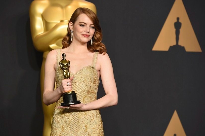"""Emma Stone poses in the press room with the award for best actress in a leading role for """"La La Land"""" at the Oscars on Sunday, Feb. 26, 2017, at the Dolby Theatre in Los Angeles. (Photo by Jordan Strauss/Invision/AP)"""