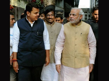 Devendra Fadnavis and Narendra Modi. PTI file image