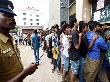 Fans queue up outside a Chennai theatre for first day first show tickets. File photo