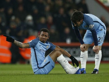 Manchester City's Gabriel Jesus (L) after sustaining an injury against Bournemouth. Reuters
