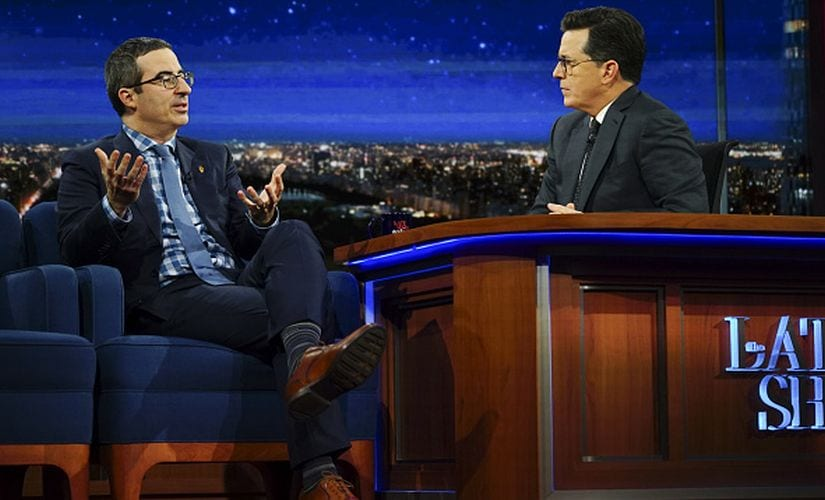 Stephen Colbert with John Oliver. Getty Images