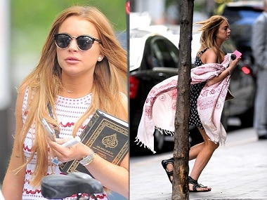Lindsay with the Quran. Photo courtesy: Twitter