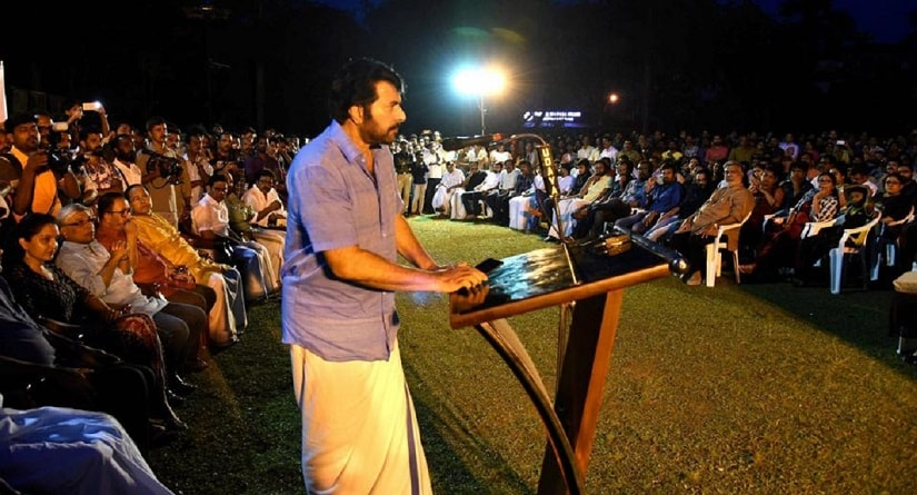Malayalam superstar Mammootty addresses a meeting of the film fraternity held to express solidarity with the actress who was assaulted. Image courtesy PTI