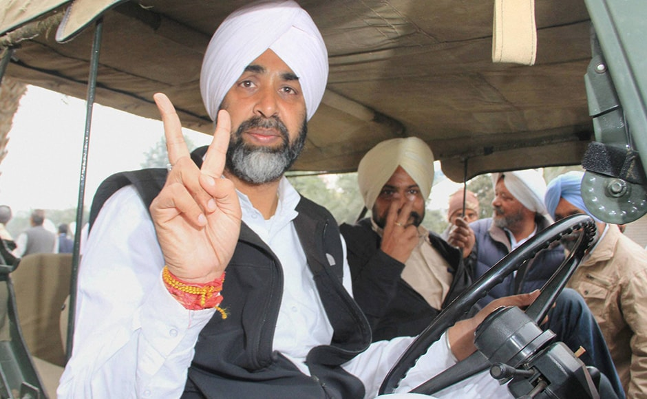 Congress candidate from Bathinda (urban) Manpreet Singh Badal showing a victory sign after casting his vote in Badal village in Muktsar district on Saturday. In this Congress versus AAP versus the SAD-BJP fight, Punjab is all set to see some interesting results on 11 March. PTI.