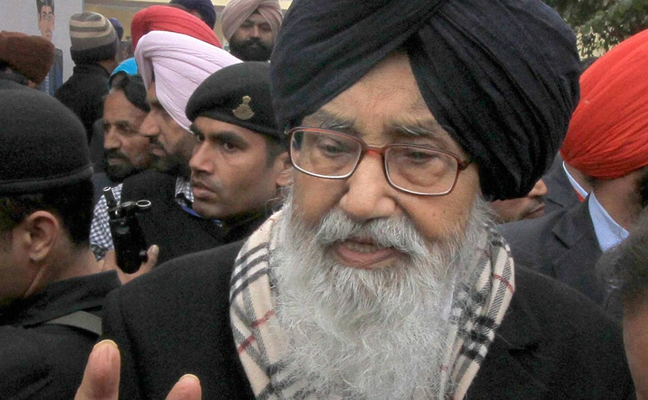 Punjab Chief Minister Parkash Singh Badal showing a victory sign after casting his vote in Badal village in Muktsar district on Saturday. The Akali Dal, BJP and Congress — the traditional parties on Punjab's political scene, are not only holding on to their existing political space but also fighting hard to ward off the challenge from AAP. PTI.