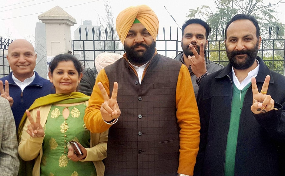 Congress Lok Sabha candidate Gurjeet Singh Aujla, along with his family members, showing a victory sign after casting his vote at a polling station in Amritsar on Saturday. PTI.