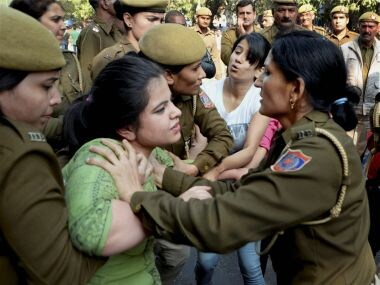 Police detain ABVP activists after their clash with AISA students at Delhi University. PTI