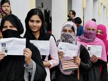 Lucknow: Voters queue up to cast their votes during the third phase of the UP assembly elections in Lucknow on Sunday. PTI Photo by Nand Kumar(PTI2_19_2017_000122B)