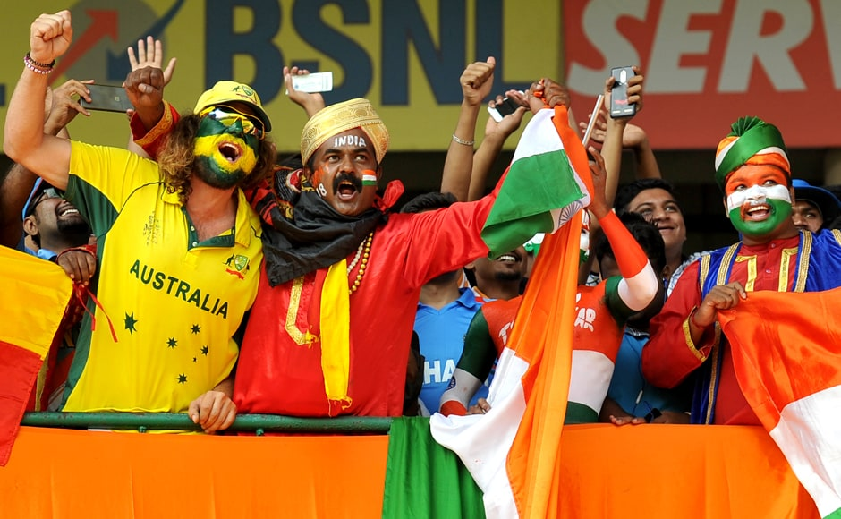 Cricket fans of both India and Australia cheer their teams during the Day 1 of the second cricket Test match between India and Australia at The M. Chinnaswamy Stadium in Bengaluru. AFP