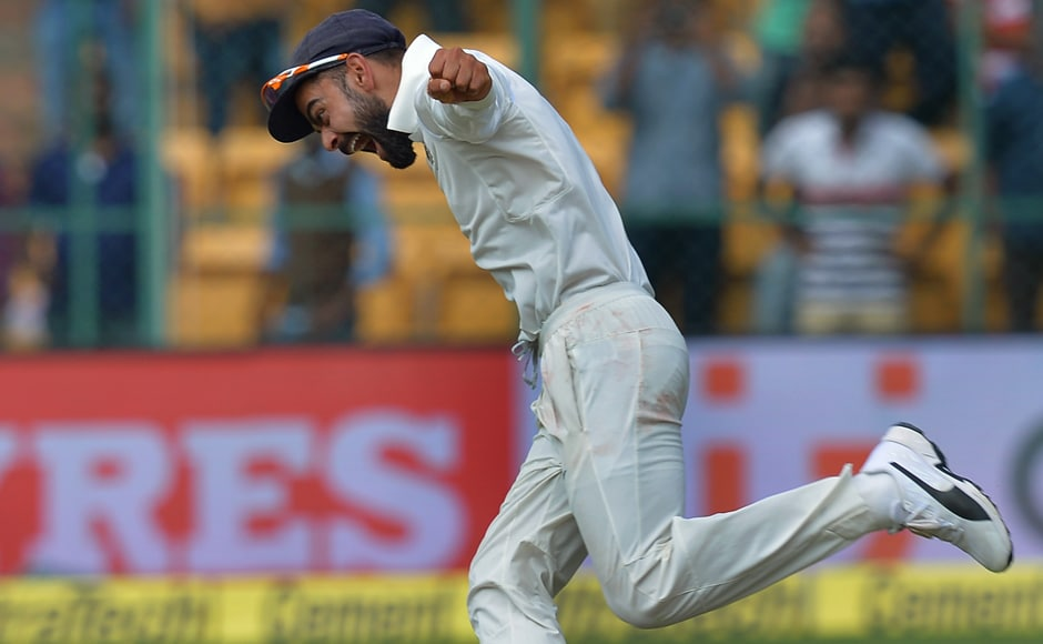 India's cricket team captain Virat Kohli celebrates the victory against Australia on the fourth day of the second Test match between India and Australia at The M. Chinnaswamy Stadium in Bangalore on March 7, 2017. AFP