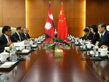 Chinese Foreign Minister Wang Yi (R) speaks with Nepal Premier's special envoy Krishna Bahadur Mahara (L) during their meeting at the Ministry of Foreign Affairs in Beijing, China, 16 August 2016. REUTERS/Wu Hong/Pool - RTX2L4EI