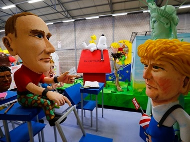 Papier mache caricatures depicting U.S. President Donald Trump and Russian President Vladimir Putin are pictured during preparations for the upcoming Rose Monday carnival parade in Cologne, Germany, February 21, 2017. REUTERS/Wolfgang Rattay - RTSZM65