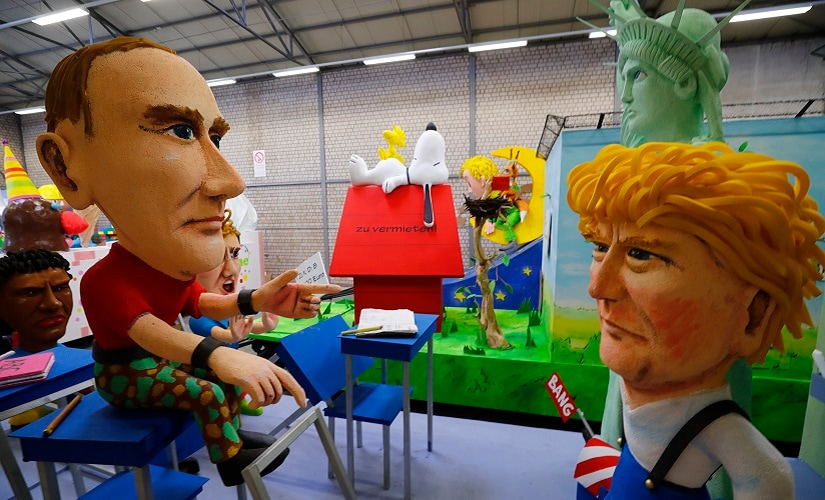 Papier mache caricatures depicting US President Donald Trump and Russian President Vladimir Putin. Reuters