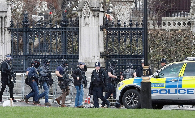 Armed police officers enter the Houses of Parliament on Wednesday. PTI