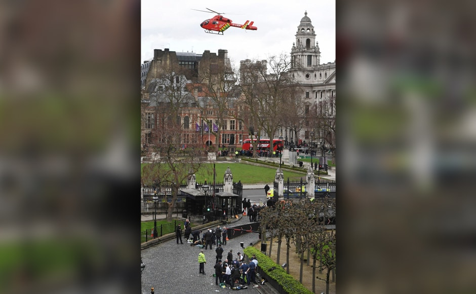 """An Air Ambulance comes in to land as emergency services attend to injured persons outside the Houses of Parliament, London. Metropolitan Police counter-terrorism chief Mark Rowley said police believed there was only one attacker, """"but it would be foolish to be overconfident early on."""" AP"""
