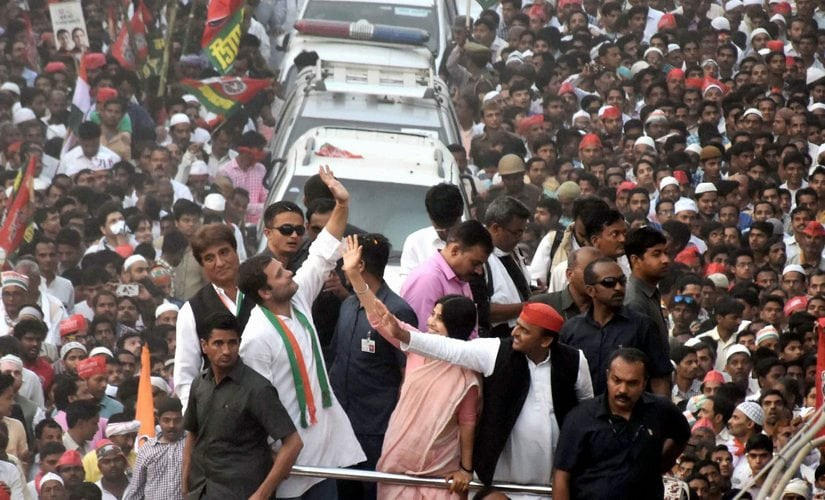 Congress Vice President Rahul Gandhi, UP Chief Minister Akhilesh Yadav with wife Dimple Yadav and other leaders during their road show in Varanasi on Saturday. PTI