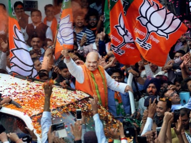 Amit Shah with BJP supporters. PTI