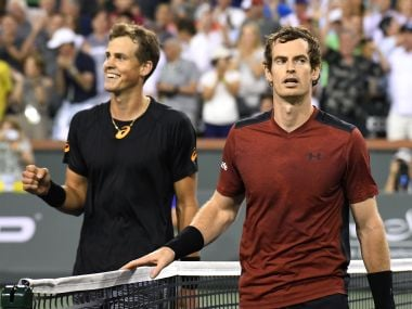 Vasek Pospisil, left, and Andy Murray, walk off the court after their match at Indian Wells. AP