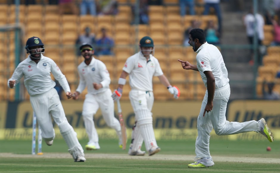 India's Ravichandran Ashwin celebrates after removing David Warner cheaply on Day 4. REUTERS