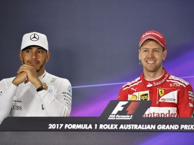 Mercedes driver Lewis Hamilton, left, and Ferrari driver Sebastian Vettel during a press conference. AP