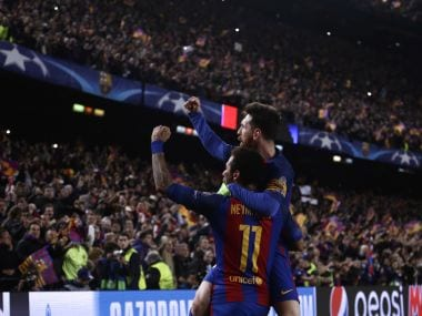Barcelona's Lionel Messi celebrates their victory with Neymar (left) on Wednesday. AP