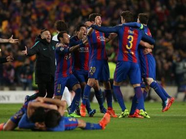 Barcelona players celebrate after the game. Reuters