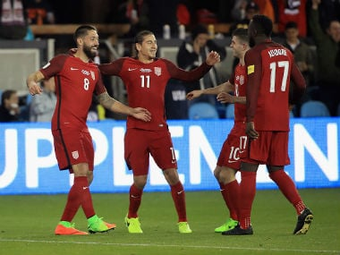 Clint Dempsey celebrates with teammates after scoring a hat-trick against Honduras. Getty Images