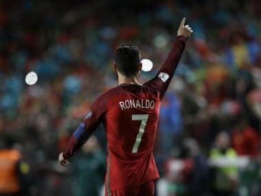 Portugal's Cristiano Ronaldo celebrates after scoring against Hungary in the World Cup qualifying match. AP