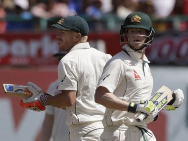 Australia's captain Steven Smith, right, and David Warner run between the wickets on Day 1. AP